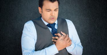 Man experiencing chest pain - Different types of heart diseases